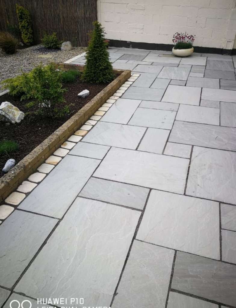 Limestone patio is ideal for a South Facing Garden